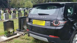 Car parked on grave