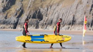 RNLI lifeguards training on Three Cliffs Bay