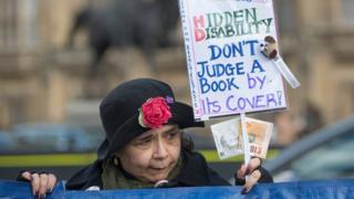 Woman protesting PIP changes