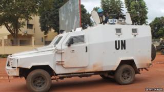 UN peacekeeping soldiers from Rwanda patrol on December 09, 2014 in Bangui.