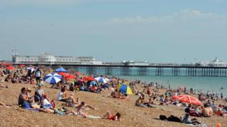 People sunbathe on a Beach.