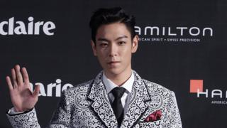 T.O.P. of Bigbang arrives for the Marie Claire Asia Star Awards during the 18th Busan International Film Festival on October 5, 2013 in Busan, South Korea.