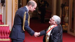 Sir Jeffrey receiving his knighthood in 2017