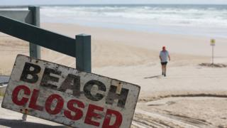 "Sign reads ""beach closed after fatal shark attack"""