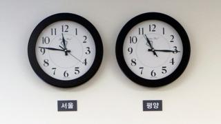 A photo made available by the South Korean Presidential Office shows Seoul time zone clock (L) and Pyongyang time zone clock (R) at the Peace House in the Demilitarized Zone (DMZ), in April 2018
