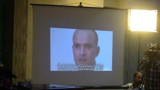 Members of the media watch a projection of a video showing arrested man Kulbhushan Jadhav, who is suspected of being an Indian spy, during a press conference in Islamabad on 29 March 2016