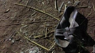 Discarded sandal outside the Puttingal temple, 10 April 2016