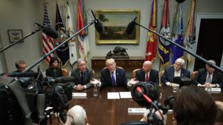 U.S. President Donald Trump (C) speaks during a meeting with members of the House Ways and Means Committee as committee chairman Rep. Kevin Brady (R-TX) (R) and ranking member Rep. Richard Neal (D-MA) (L) listen September 26, 2017 at the Roosevelt Room of the White House in Washington, DC. President Trump met with members of the committee to discuss tax reform.