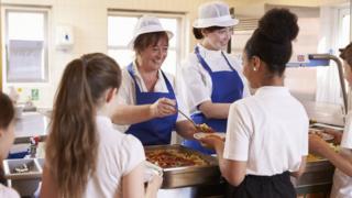 Children being served school meals