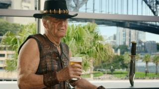 Paul Hogan briefly reprises his role in the advert, standing in front of the Sydney Harbour Bridge