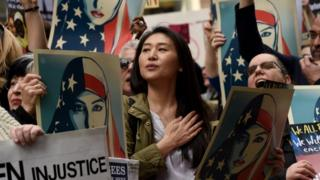 A protest in New York against the ban. The state is one of several to launch legal challenges