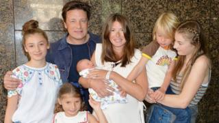 Jamie and Jools Oliver with their five children outside hospital