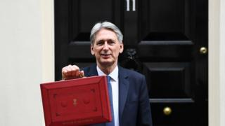 Philip Hammond outside 11 Downing Street before March's Budget