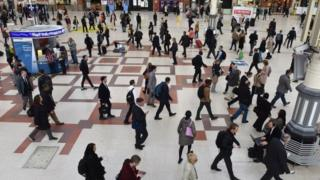 Commuters at Victoria station in London