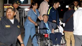 Former Peruvian President Alberto Fujimori accompanied by his son Kenji Fujimori (R) leaves the Centenario hospital in Lima, Peru, 4 January 2018.
