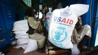 Sudanese dockers unload a US aid shipment organised by the US Agency for International Development and the World Food Programme at Port Sudan