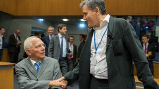 German Finance Minister Wolfgang Schaeuble (L) and Greece Finance Minister Euclid Tsakalotos (R)