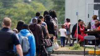 Asylum seekers wait to be processed at the Quebec-New York crossing