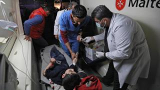 A Syrian boy is treated in an ambulance following his arrival in Qalaat al-Madiq, north-west of the city Hama, on 2 April 2018