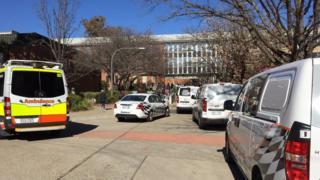 Police cars and ambulances at the Australian National University