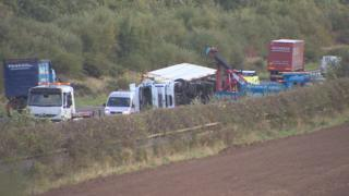 A lorry has overturned on the A1 in high winds