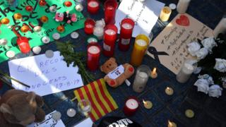 candles and other tributes left at the scene of the van attack in Barcelona