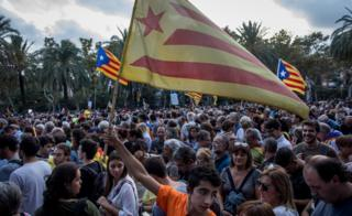 People gather to hear Catalan President Carles Puigdemont speak on October 10, 2017 in Barcelona