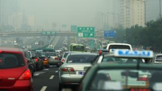 Heavy air pollution above cars driving in Beijing