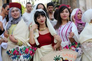 """Tunisian women wearing traditional veils called """"Sefseri"""" during the celebrations of the National Women""""s Day and the 61th anniversary of the Personality Status Code in Tunis, Tunisia on 13 July 2017"""