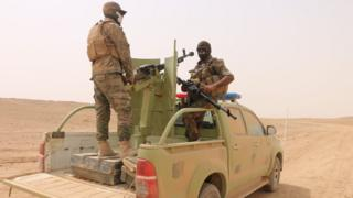 Paramilitary fighters stand on a vehicle south of Ana, in Anbar province, Iraq (20 September 2017)