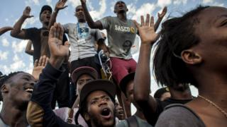 Students cheer after the Cecil Rhodes statue was removed from the University of Cape Town in South Africa on 9 April 2015