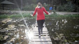 Uma crosses a bridge