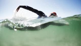 Man swimming in open water