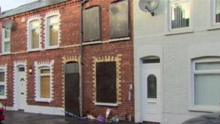 Flowers were left outside Matthew Goddard's house where his body was found over Christmas 2014