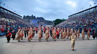 The Royal Jordanian Honour Guard and band stand to attention at the military tattoo