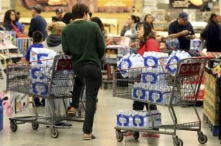 shoppers buy water