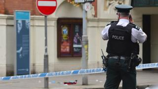 Police at the scene near the Grand Opera House in Belfast on Thursday