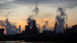 Sunrise behind the Tata steel plant