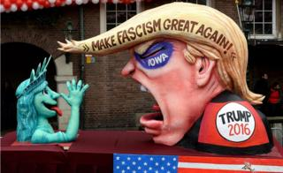 A carnival float mocking US Republican presidential candidate Donald Trump stands on display near city hall on February 8, 2016 in Duesseldorf, Germany