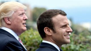 US President Donald Trump (L) in addition to French President Emmanuel Macron watch an Italian flying squadron