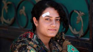 Female Kurdish fighter