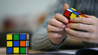 A seventh grade student of the 'Free Christian' school in Duesseldorf trys out the Rubik's Cube for the first time on November 9, 2010.