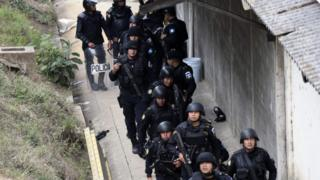 Riot police agents are pictured after the operation to rescue the four hostages kept held by inmates at the Stage II Male Juvenile Detention Center in San Jose Pinula, east of Guatemala City, 20 March 2017