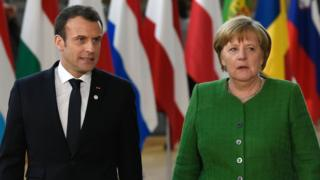 France's President Emmanuel Macron and Germany's Chancellor Angela Merkel arrive for an informal meeting of the 27 EU heads of state in Brussels, 23 February 2018