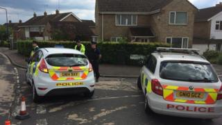 Police cars in Belmont Close