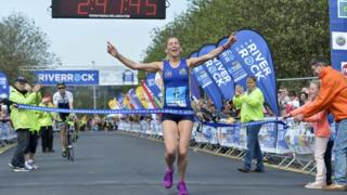 Kilkeel woman Laura Graham crosses the finish line, Belfast City Marathon, 1 May 2017
