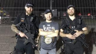 Man with two armed officers