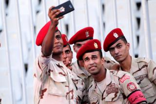 Egyptian military police soldiers take a selfie before the beginning of the match between ES Tunis, and Al Hilal during the Arab Club championship, at Borg Al Arab Stadium, in Alexandria, Egypt, 30 July 2017