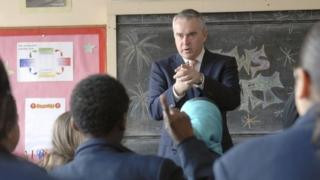 Huw Edwards at a school