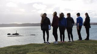School pupils look out to the site of the Iolaire Disaster